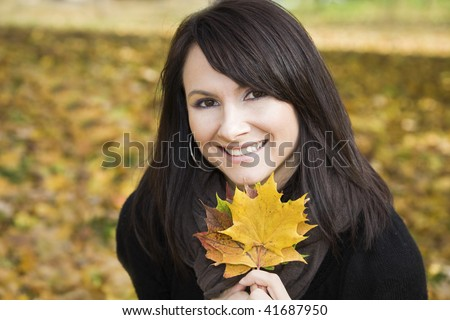 Smiling young lady in the park - stock photo