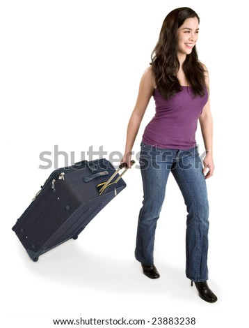 Smiling Young Lady Pulling her Luggage - stock photo