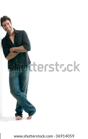 Smiling young latin man standing against a white wall with copy space for your text isolated on white background - stock photo