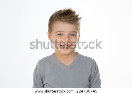 smiling young little boy in commercial pose - stock photo