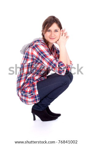smiling young long hair woman in check shirt, full length, series - stock photo