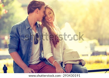 Smiling young love in love outdoor  - stock photo
