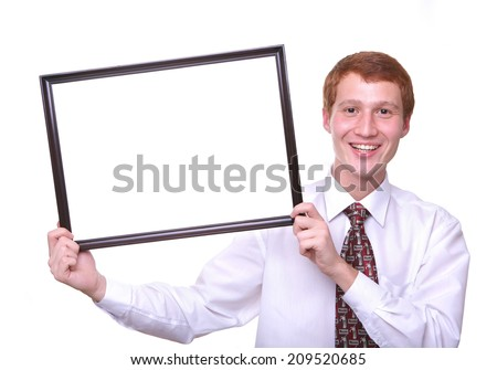 smiling young man holding a frame isolated on white