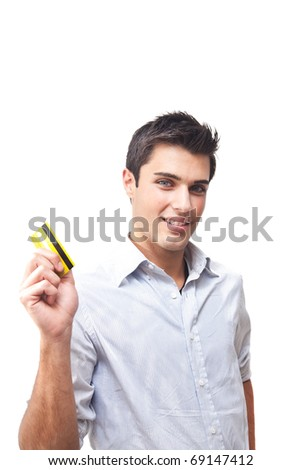 Smiling young man holding credit card - stock photo