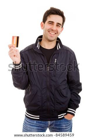 Smiling young man holding credit card, isolated on white - stock photo