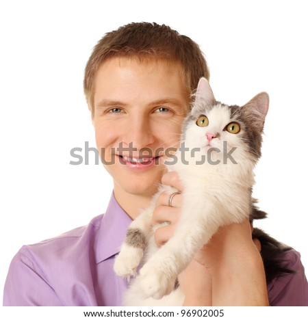 Smiling young man holds cat isolated on white background; cat looks up - stock photo