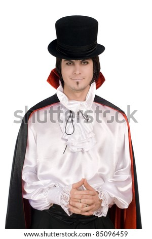 Smiling young man in a suit of Count Dracula - stock photo