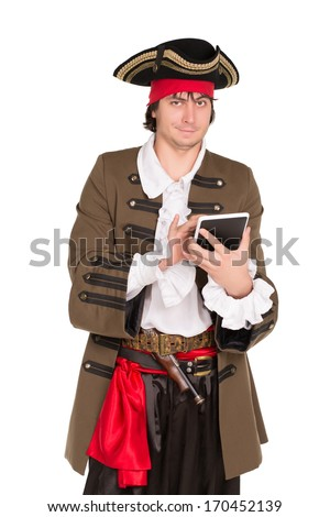 Smiling young man in pirate costume posing with a tablet. Isolated on white