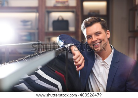 Smiling young man in store