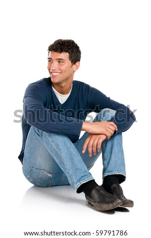 Smiling young man looking away with embarassement isolated on white background - stock photo