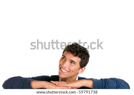 Smiling young man looking up at copy space for your text isolated on white background - stock photo