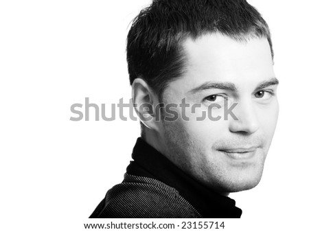 Smiling Young man's face close up isolated - stock photo