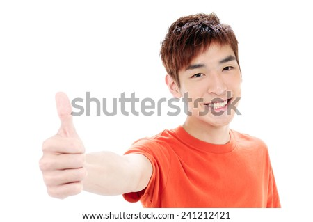 Smiling young man showing thumbs up - stock photo