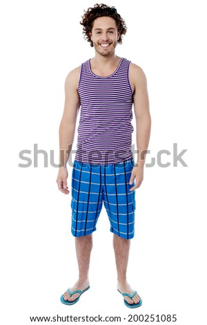 Smiling young man standing in swimwear - stock photo