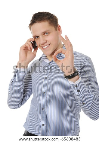 smiling young man talking on the phone - stock photo