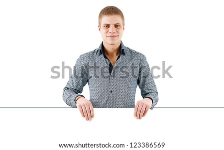 smiling young man with a white poster - stock photo