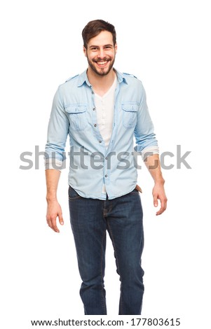 smiling young man with beard in a blue shirt on white background
