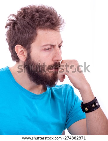 Smiling young man with beard posing with a blue shirt - stock photo