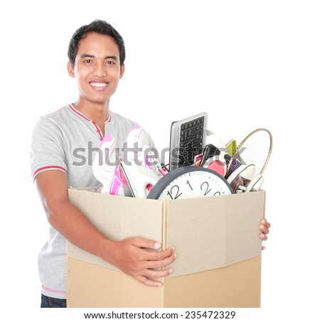 Smiling young man with cardboard box. moving day concept - stock photo