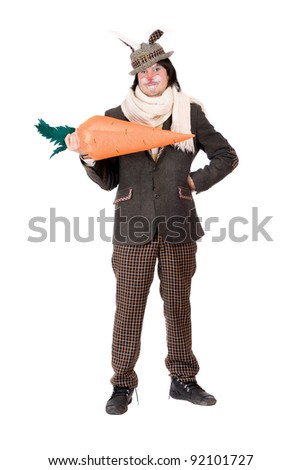 Smiling young man with carrot dressed in a suit rabbit - stock photo