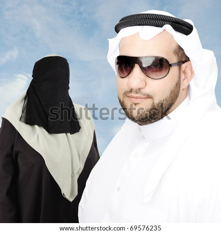 Smiling young man with his woman, arabic traditional clothes - stock photo