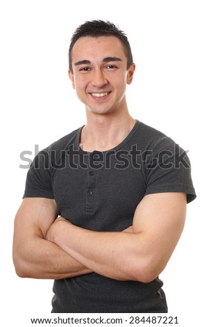 smiling young man with muscular arms folded or crossed isolated on white                              - stock photo
