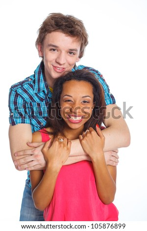 Smiling young man with pretty girlfriend. Isolated on white background.