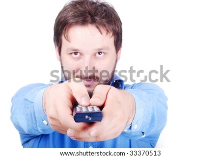 Smiling young man with remote control in hands - stock photo