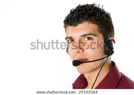Smiling young man with telephone headset isolated on white background - stock photo