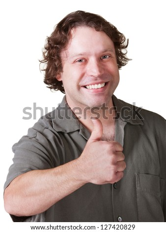 Smiling young man with thumbs up gesture - stock photo