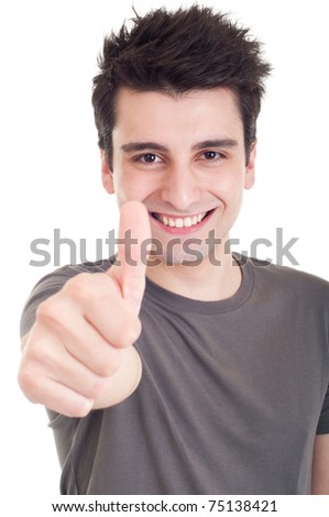 smiling young man with thumbs up on an isolated white background - stock photo