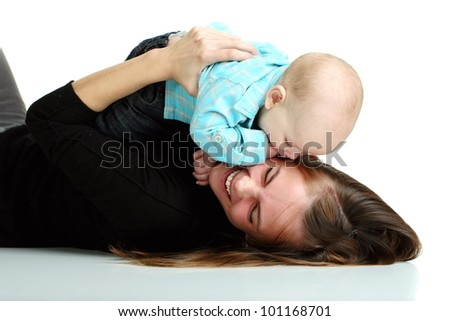 Smiling young mother holding her baby in her arms