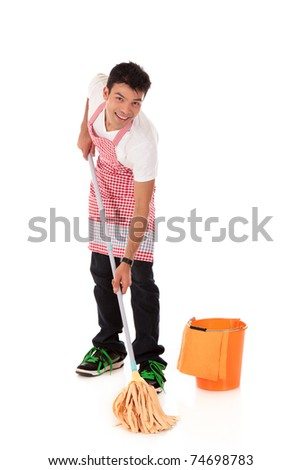 Smiling young Nepalese man doing housework, mopping. Studio shot. White background. - stock photo