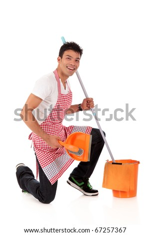Smiling young Nepalese man doing housework. Studio shot. White background. - stock photo