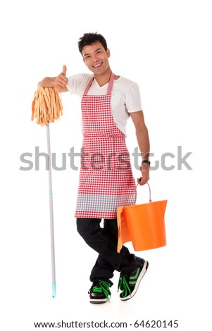 Smiling young Nepalese man with thumb-up, doing housework. Studio shot. White background. - stock photo