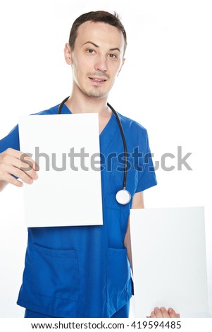smiling young nurse man with empty board isolated on white