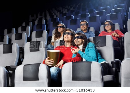 Smiling young people look cinema in 3d - stock photo