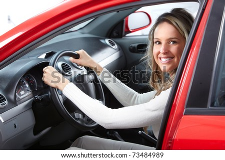 Smiling young pretty woman  in the car - stock photo