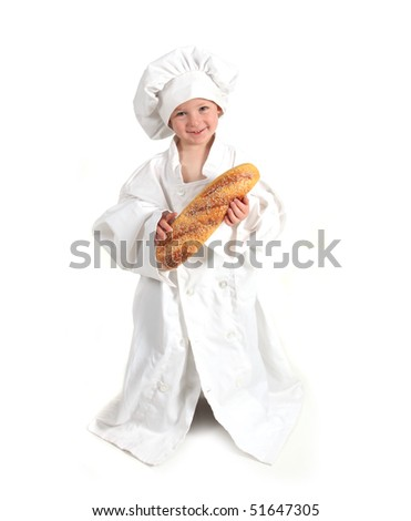 Smiling Young Professional Chef to Be Holding a Loaf of Bread - stock photo