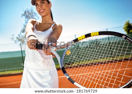 smiling young sporty girl playing tennis - stock photo