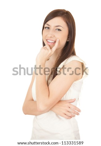 smiling young student girl, looking at camera, white background - stock photo