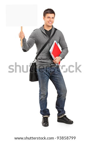 Smiling young student holding a white empty banner isolated on white background
