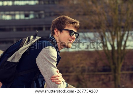 Smiling young student relaxing.Thinking student,Relaxing,Outdoors.Park. - stock photo