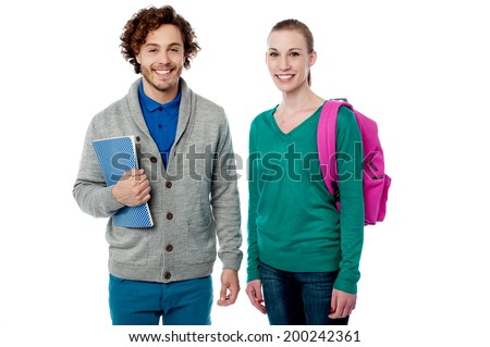 Smiling young students with bag and note book - stock photo