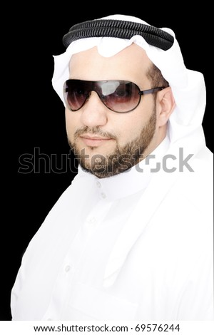 Smiling young success man, arabic traditional clothes - stock photo