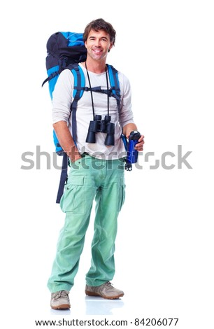 Smiling young tourist. Isolated over white background.