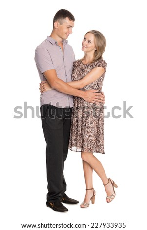 Smiling young woman and man hugging each other  - stock photo
