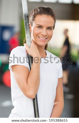 Smiling young woman at center