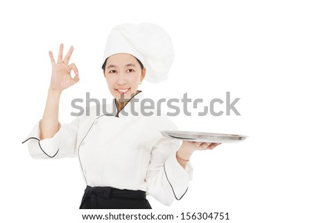 smiling young woman chef with empty food tray - stock photo