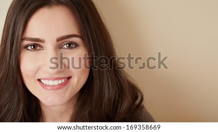 Smiling young woman closeup with perfect dental teeth  - stock photo